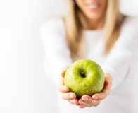 Woman holding fresh green apple Stock Photos