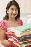 Woman Holding Fresh Laundry Royalty Free Stock Images