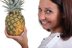 Woman holding fresh pineapple Royalty Free Stock Image