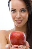 Woman holding fresh red apple,selective focus on woman Stock Photos
