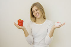 Woman holding fresh red paprika and delicious pancake Stock Photo