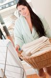 Woman holding fresh towels in the basket Stock Photography