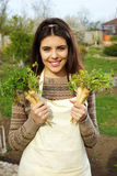 Woman holding fresh vegetables in garden Royalty Free Stock Images