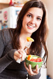 Woman holding a fruit bowl Royalty Free Stock Photography
