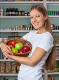 Woman Holding Fruits Basket At Supermarket Stock Photos