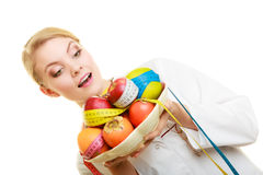 Woman holding fruits dietitian recommending healthy food. Stock Photography