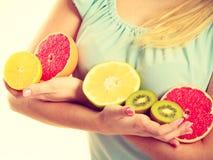 Woman holding fruits kiwi. orange, lemon and grapefruit Stock Photography