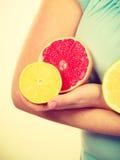 Woman holding fruits kiwi. orange, lemon and grapefruit Stock Image
