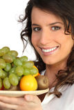 A woman holding a fruits plate Stock Photo