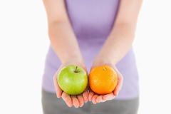Woman holding fruits while standing Royalty Free Stock Photo