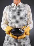 Woman Holding a Frying Pan Royalty Free Stock Photography