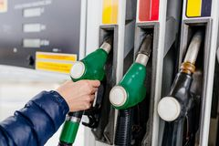 Woman holding a fuel nozzle Royalty Free Stock Photography