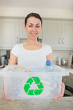 Woman holding full recycling bin Stock Photography