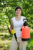 Woman holding  garden spray Stock Image