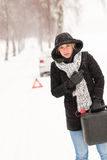 Woman holding gas can winter car breakdown. Woman holding gas can snow car breakdown winter help road stock images