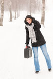 Woman holding gas can winter car trouble. Woman holding gas can snow car trouble winter road breakdown Royalty Free Stock Photography
