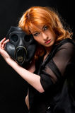 Woman holding gas mask stock photo