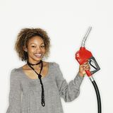 Woman holding gas nozzle Stock Photography
