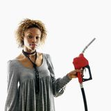 Woman holding gas nozzle Stock Photo