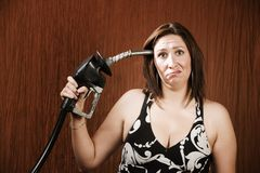 Free Woman Holding Gas Nozzle To Her Head Royalty Free Stock Photos - 6363728