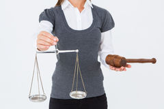 Woman holding a gavel and scales of justice Stock Image