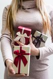 Woman gift gender present holiday celebration. Woman holding gender presents for friends or colleagues on various holidays and celebration royalty free stock photo