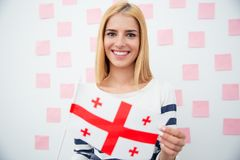 Woman holding Georgia flag Stock Image