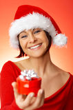 Woman holding gift Royalty Free Stock Images