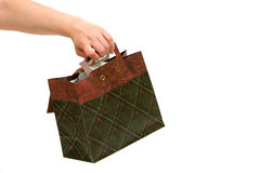 Woman holding gift bag Royalty Free Stock Photos