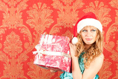 Woman holding a gift Royalty Free Stock Image