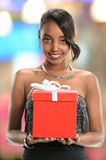 Woman Holding Gift Bow with Ribbon Royalty Free Stock Images