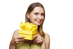 Woman holding gift box Royalty Free Stock Images