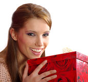 Woman holding a gift box Stock Photography