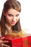 Woman holding a gift box Stock Photos