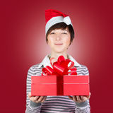 Woman holding gift box Stock Images