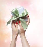 Woman Holding Gift Box Royalty Free Stock Photos