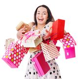 Woman holding gift box at birthday party. Royalty Free Stock Images