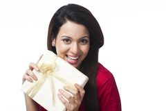 Woman holding gift box Royalty Free Stock Photos