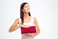 Woman holding gift box and looking up Royalty Free Stock Photos