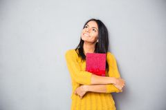 Woman holding gift box and looking up Royalty Free Stock Image