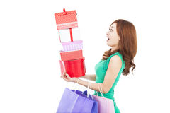 Woman holding gift box and shopping bag Stock Photos