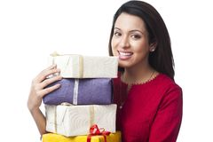 Woman holding gift boxes Royalty Free Stock Photos