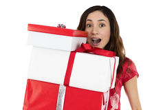 Woman holding gift boxes with excitement Stock Images