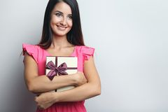 Woman holding gift boxes Royalty Free Stock Image
