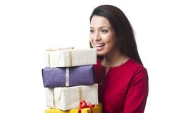 Woman holding gift boxes Stock Images