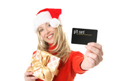 Woman holding gift card, credit card etc royalty free stock images