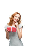Woman holding gift Royalty Free Stock Photos