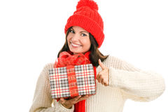 Woman holding gift giving thumbs up Royalty Free Stock Image