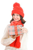 Woman holding gift giving thumbs up. Young happy woman holding gift indicating thumbs up isolated on white background Stock Image