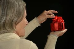 Woman holding a gift Stock Image